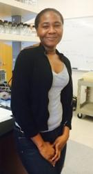 Rhoda Brew-Appiah standing in a lab.