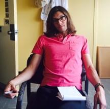 Alex Mojcher sitting in a chair.