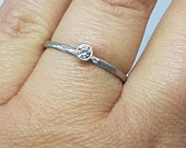 1.5mm wide recycled platinum and 3mm diamond engagement ring.