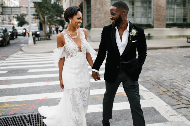 Stylish bride and groom crossing a city street | Elopement Checklist
