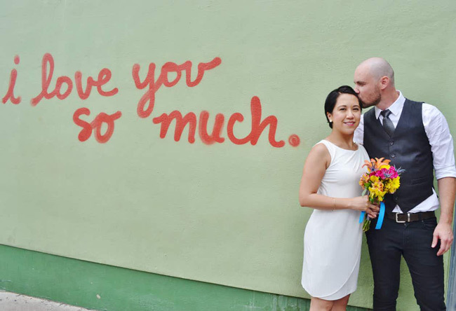 "Couple elopes in Austin in front of ""I love you so much"" mural 