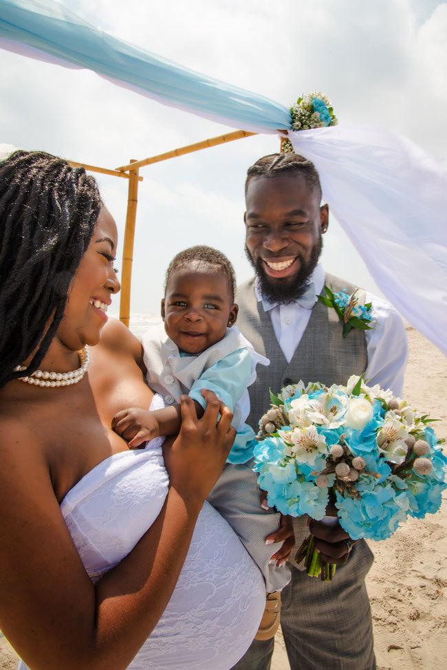 Cute pregnant bride eloping on the beach