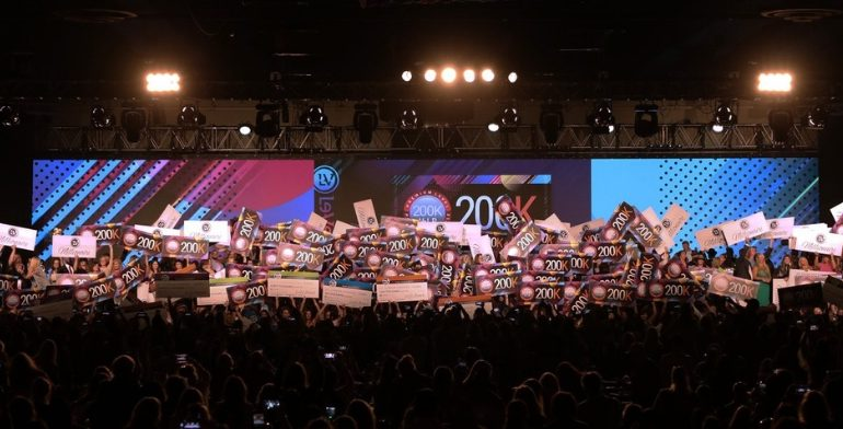 Top Le-Vel Promoters on stage at THRIVEPALOOZA, the company's annual convention, celebrating their success.