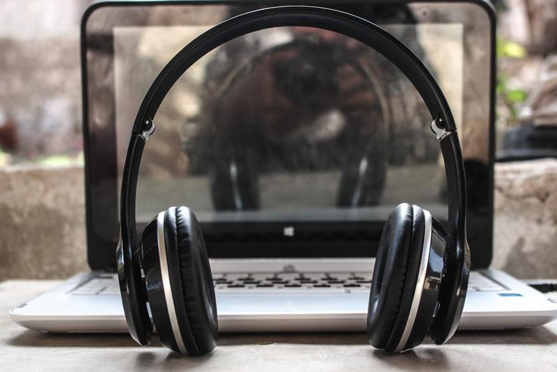 Headphones in front of a computer