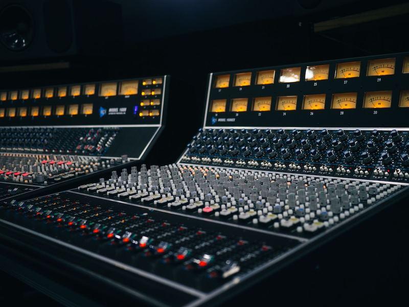 Older recording studio equipment beside itself