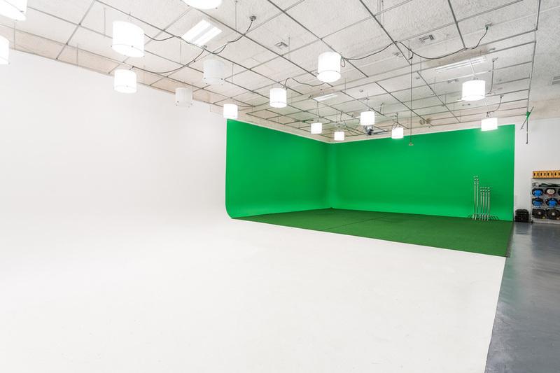 A wide shot of a green screen studio space in Miami
