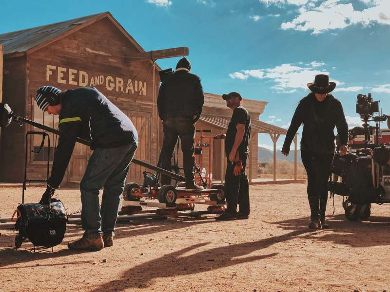 Four filmmakers using a location checklist to film a western