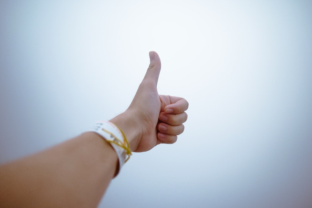 Guy giving a thumbs up