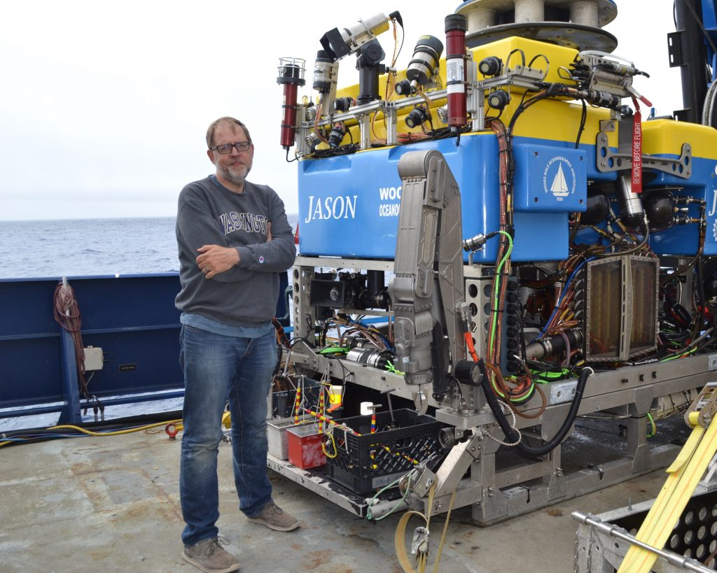 Rob Fatland hanging out with Jason on the deck of the R/V Roger Revelle. Credit: M. Elend, University of Washington, V18.