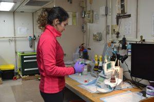 Romina Cennturion titrating oxygen samples on board the RV Revelle. Credit: Julie Nelson, University of Washington, VISIONS18