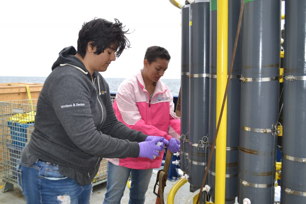 University of Washington students Katie Gonzalez and Eve Hudson sample the CTD Rosette.  Credit: M. Elend, University of Washington, V18.