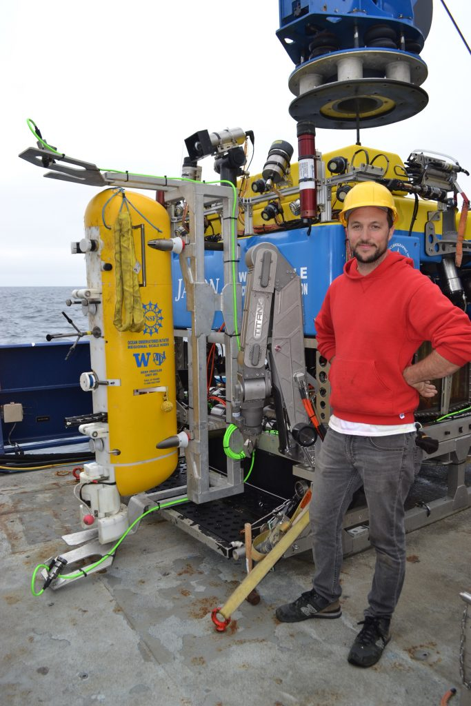 APL engineer Nic Hart next to the deep profiler loaded onto Jason.  Credit: M. Elend, University of Washington, V18.