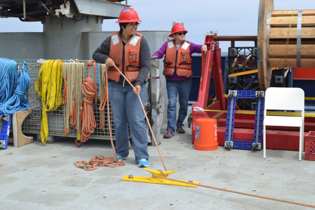 UW undergraduate Katie Gonzalez secures a line during the deep profiler deployment at Slope Base. Credit: Y. Meghare, Univeristy of Washington, V18.