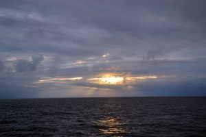 The sun sets on the waters above Axial Seamount during the last night of operations at this site. Credit: M. Elend, University of Washington, V18.