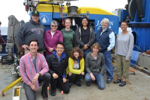 University of Washington students and mentors gather in front of the ROV Jason near the end of the Leg 2 UW VISIONS program. Front, left to right: Erik Friedrickson [School of Oceanography (SoO) graduate student], Bing-Yu Lee (SoO and Earth and Space Sciences), Riah Buchanan (Digital Arts and Experimental Media graduate student), Katie Bigham (Cabled Array team, mentor). Back left to right: Brison Grey (SoO undergrad), Julie Nelson (Grays Harbor College professor, mentor), Amy Larsen (SoO undergrad), Katie Gonzalez (SoO undergrad), Deb Kelley (Instructor), Eve Hudson (SoO undergrad). Credit: M. Elend, University of Washington, V18.