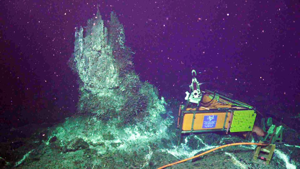 """On July 4, the OOI Cabled Array high definition camera, built by the UW, was reinstalled at the actively venting chimney """"Mushroom"""" in the ASHES hydrothermal field on Axial Seamount. Credit: UW/NSF-OOI/WHOI, V18."""