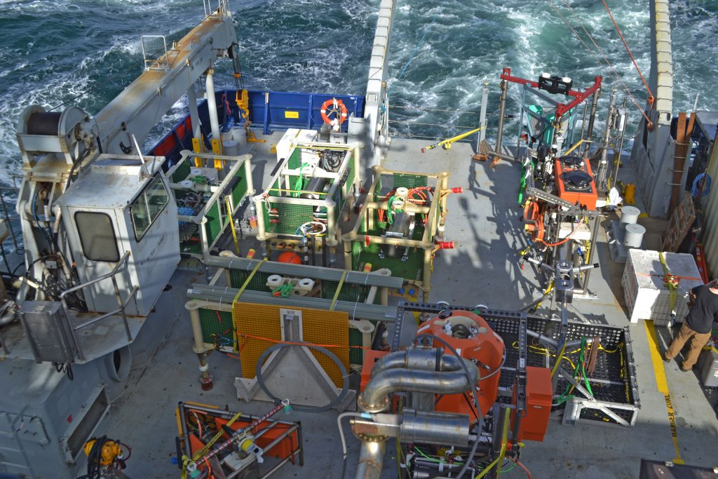 The R/V Revelle transits to Axial Seamount at the beginning of Leg 2 of the NSF-OOI-UW Cabled Array VISIONS18 cruise. Credit: E. Hudson, University of Washington, V18.