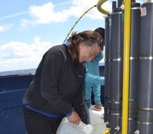 Terrie Manning, a member of the VISIONS18 program, takes water samples collected from 2900 m at the Slope Base site. Credit: M. Elend, University of Washington, V18.