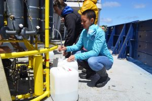UW Oceanography undergraduate student takes water samples collected >9500 ft beneath the oceans surface on VISIONS18. Credit: M. Elend, University of Washington, V18.