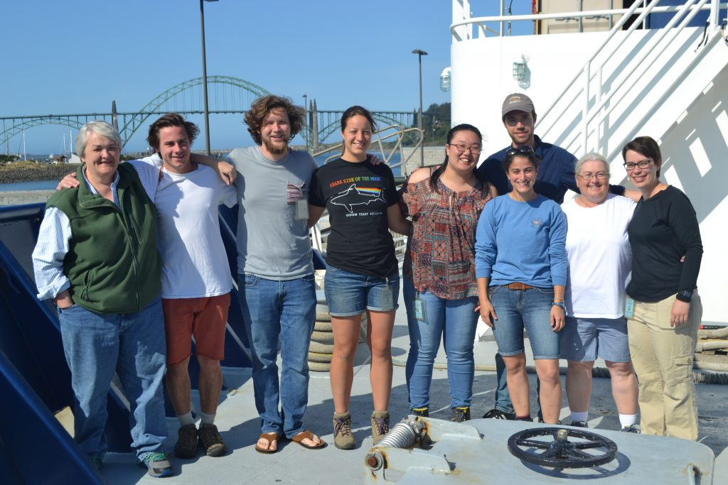 Students and educators gather on the bow of the R/V Revelle at the end of the VISIONS'17 UW-OOI-NSF Operations and Maintenance cruise. From left to right: Deb Kelley (Chief Sci), Kevin Lally, Zach Cooper, Chanelle Cadot, Michelle Lee, Kevin Eyer, Sasha Seroy, Cheryl Greengrove, Theresa Whorley, Hanis Zulsikha (not in picture). Credit: M. Elend, University of Washington.