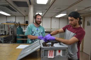 Undergraduate students Carlos Arcilia (right) from the University of Puerto Rico and Willem Weertman from the University of Washington help process CTD fluid samples. Credit: M. Elend, University of Washington, V17.