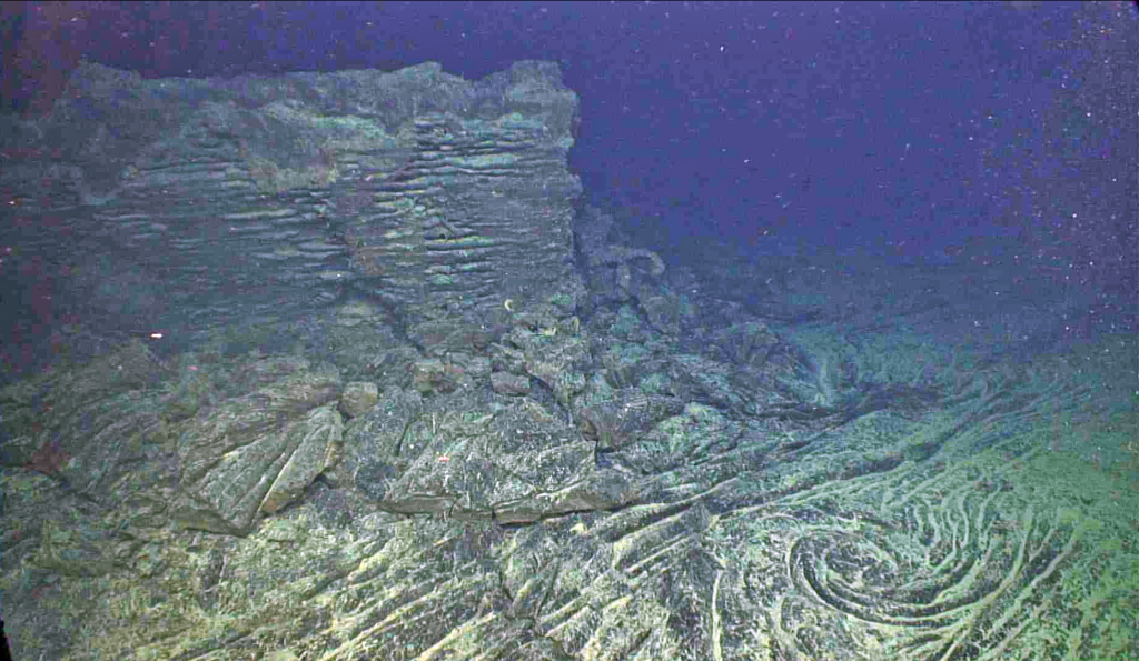 "A ""fossilized"" whirl in a lava lake that was active during the April 2011 eruption of Axial Seamount. Credit: UW/OOI-NSF/WHOI; J2-980; V17."