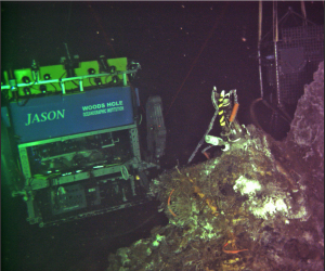Jason gets a live portrait taken while diving in the International District Hydrothermal Field by the Regional Cabled Array digital still camera. The lights on the ROV were turned off, and APL engineers in the UW Operations turned the camera on from onshore, >500 km away. Credit: UW/OOI-NSF, V17.
