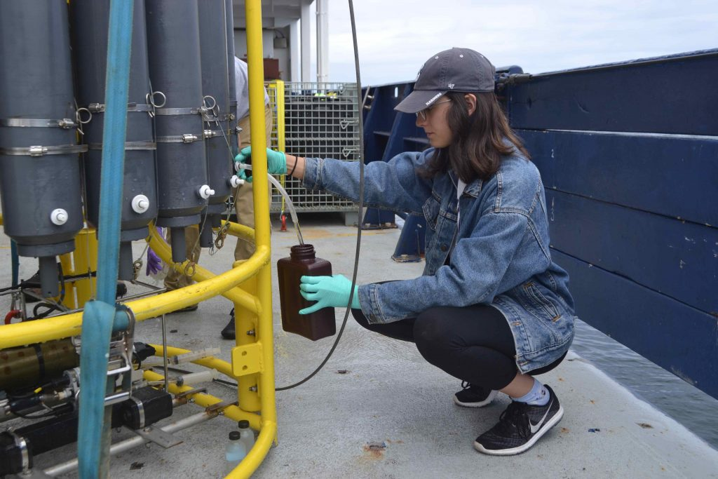 Kelsy Cain, a student in the Kelley Lab at the UW Center for Environmental, takes water samples to filter, and then grow microbes under experimental conditions. Credit: M. Elend, University of Washington.