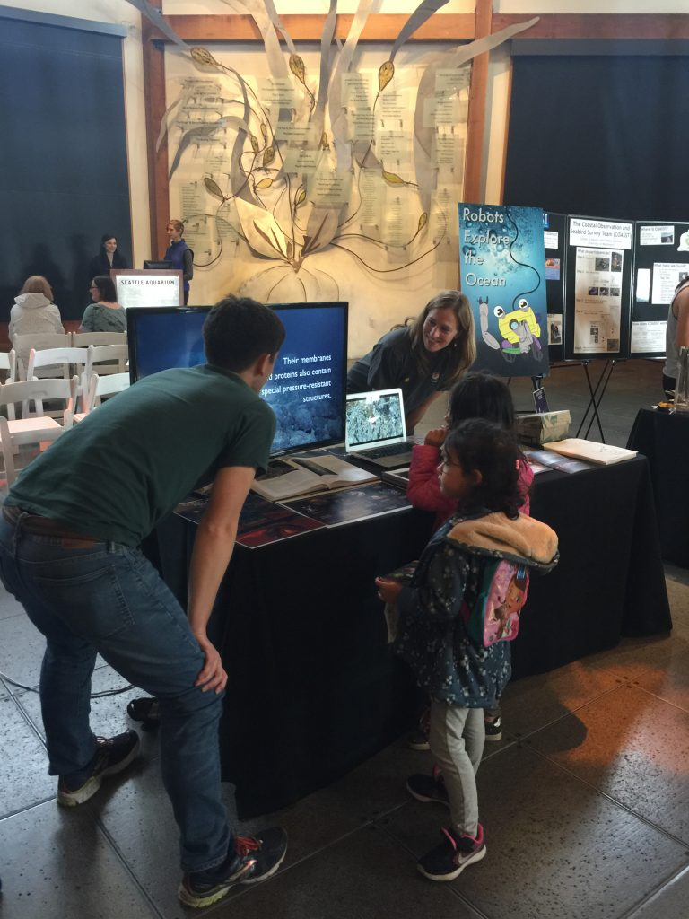 Dana Manalang (Applied Physics Laboratory engineer) and Brendan Philip (School of Oceanography graduate student) share the marvels of deep sea exploration and the underwater cabled observatory at the Seattle Aquarium's Discover Science Event 2016.