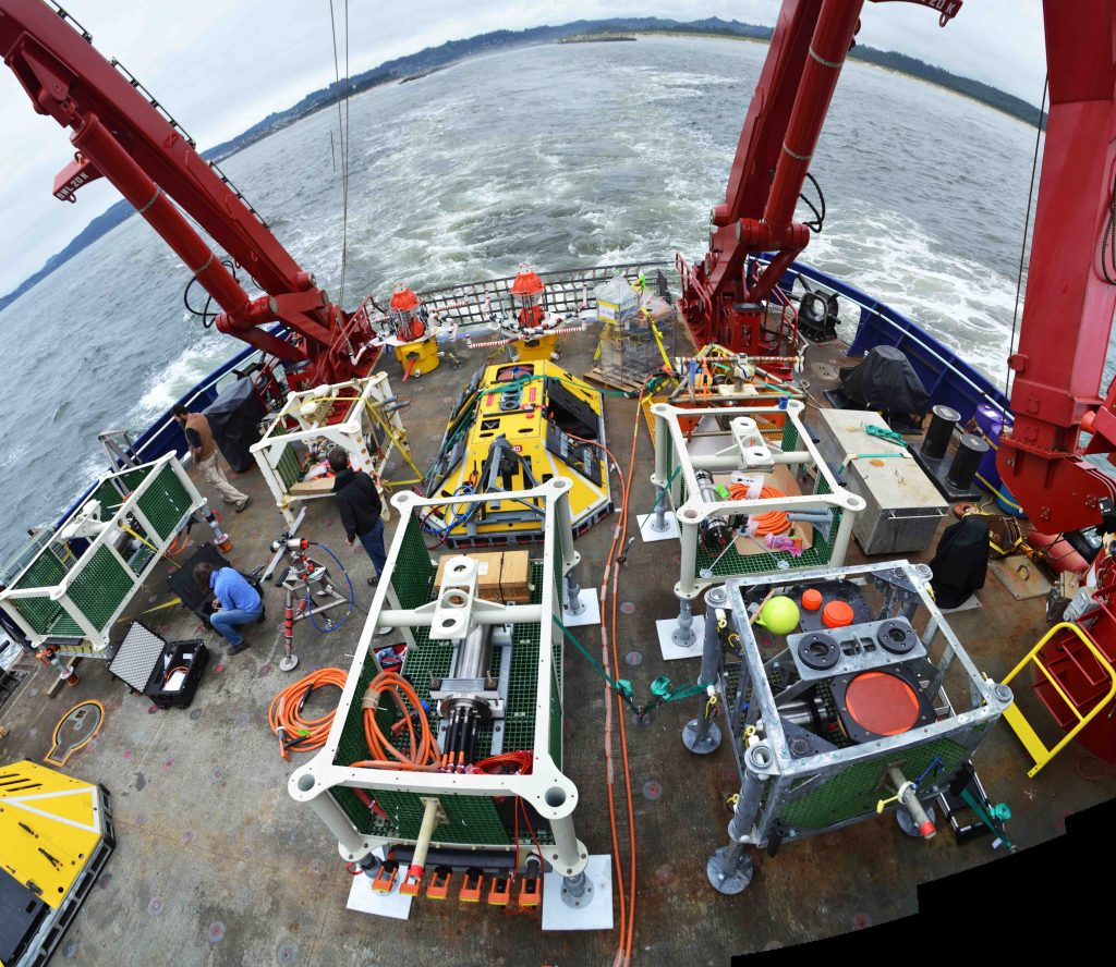 The aft deck of the R/V Sikuliaq is loaded with Cabled Array equipment to be installed during Leg 2 of the OOI Cabled Array VISIONS'16 cruise. Credit: M. Elend, University of Washington, V16.