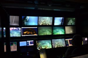 A view of the myriad screens inside the Jason control van during Jason Dive 921 at Southern Hydrate Ridge. Credit. M. Elend, University of Washington, V16.