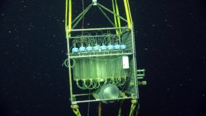 Close up of the Remote Access Fluid Sampler (RAS) built by D. Butterfield at NOAA-PMEL-UW. A nozzle is installed in an active venting site on the El Gordo chimney. Controlled from shore, or by a mission plan, a pump sucks in hydrothermal fluid into sterile bags (and also onto filters for collection of DNA in a similar system above the RAS). During annual Cabled Array maintenance cruises, this coupled mooring is recovered and collected material analyzed, with results provide at oceanobservatories.org. Credit: UW/NSF-OOI/WHOI; Dive J2-212, V16.