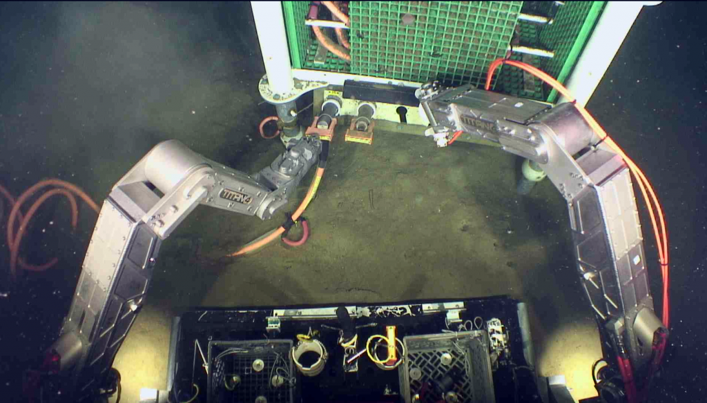 The ROV Jason plugs in the low-power junction box 9500 ft beneath the oceans surface at the Slope Base site. Credit: UW/OOI-NSF/WHOI, V16.