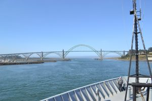 View of the bridge near the entrance to Newport while heading out for the start of Leg 3. Credit: Mitch Elend, UW; V15.