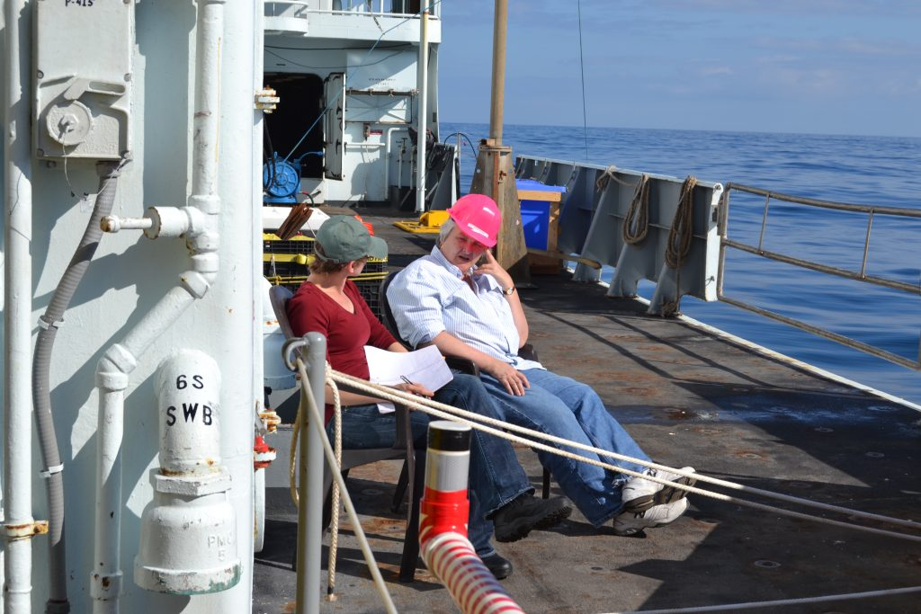 Jessica Noe (left) on deck enjoying the sun on an unusually calm day and using the opportunity to pester Deb Kelley (right) with even more questions about the OOI. Credit: Tracie Barry, Grays Harbor College, V15