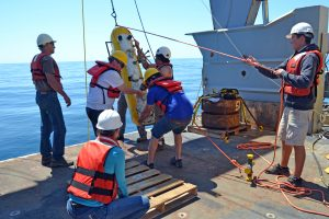 THe UW Applied Physics Lab team brings in the Deep Profiler off of the mooring cable and onto the R/V Thompson during Leg 2 of the Cabled Array VISIONS'15 cruise. Credit: University of Washington; V15.