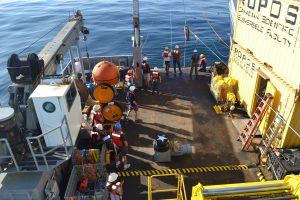 The UW Applied Physics Lab team and the R/V Thompson crew are about to pull in the mooring cable on the Deep Profiler Mooring at the Oregon Offshore site. Credit: University of Washington, V15.