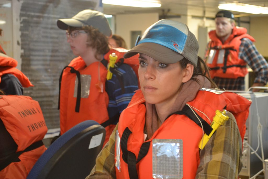 Tracie intent on taking in the first fire and safety meeting onboard the R/V Thompson during Leg 2 of the VISIONS'15 expedition. Credit: Mitch Elend, University of Washington; V15.