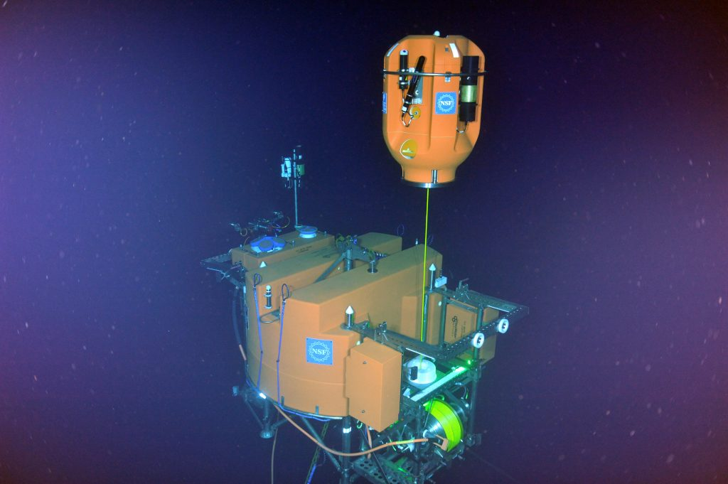 A first glimpse of the shallow winched profiler coming out of its docking station at the base of Axial Seamount. NSF/OOI/UW/ISS; Dive R1842; V15.