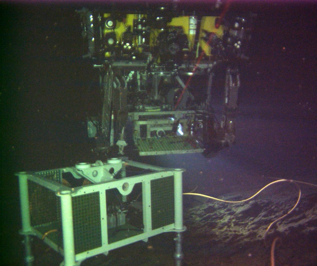 The newly installed digital still camera at the El Gordo vent within the International District hydrothermal field catches ROPOS above the mass spectrometer. Credit: NSF/OOI/UW, V15.