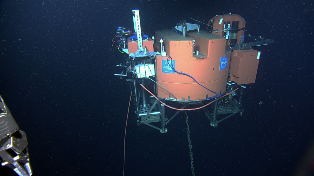 A side-looking view of the 12 ft-across Shallow Profiler Mooring platform hosting newly installed instrumented science pods. Credit: NSF-OOI/UW/ISS; Dive R1831; V15.