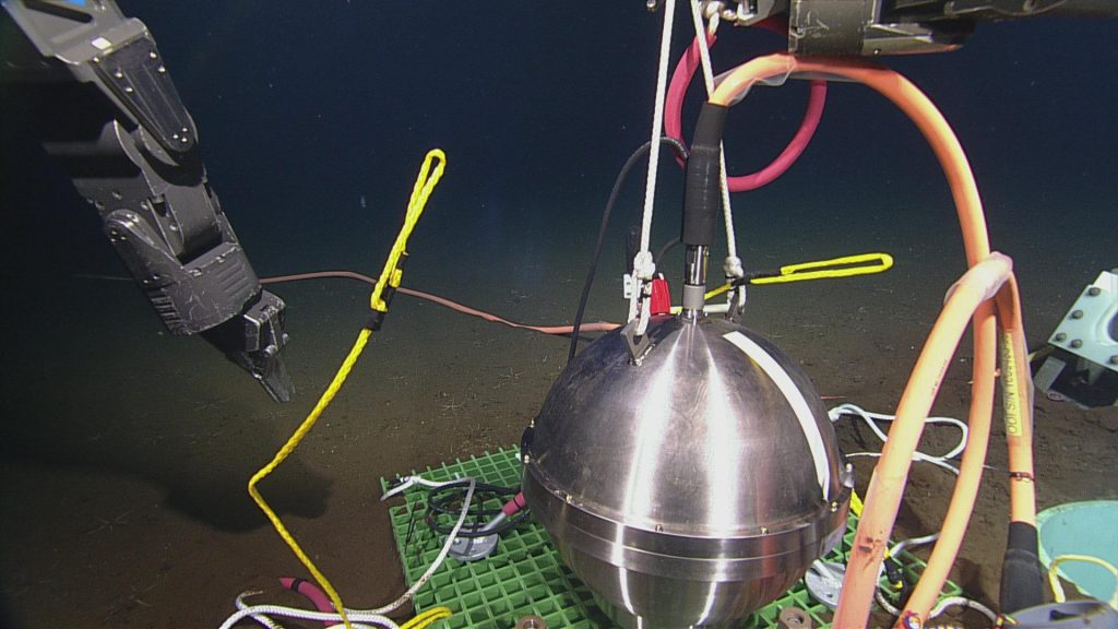 The Broadband Ocean Bottom Seismometer OBSBKA301 was deployed near MJ03A during Visions'14. The seismometer was placed into a caisson, then surrounded with silicone beads to solidify its position. Photo credit: NSF-OOI/UW/CSSF; Dive R1739; V14.
