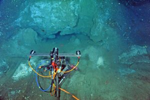 The digital still camera (CAMDSB103) sits atop a small, heavily sedimented rampart in front of the actively venting methane seep called Einstein's Grotto at the summit of Southern Hydrate Ridge. Photo credit: NSF-OOI/UW/CSSF; Dive R1767; V14.