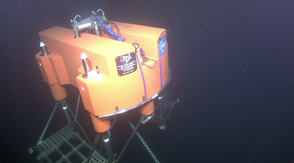 The 13 ft-across platform at the EA Offshore Site (197 m water depth) is visited by the ROV ROPOS prior to installation of the Shallow Profiler and Instrument Platform on a follow-on dive. Photo credit: NSF-OOI/UW/CSSF; Dive R1762; V14.