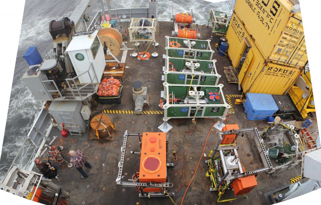 The back deck of the R/V Thompson was fully loaded with instruments, junction boxes, cable spools, and mooring components that were installed during Leg 4. Image Credit: Skip Denny, UW-APL; V14.