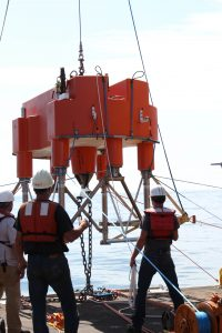 Deployment of the 200m platform of the Endurance Oregon Offshore two-legged mooring, which will eventually host a winched shallow profiler and bioacoustic sonar instruments. Two mooring lines with seafloor anchors are attached to the sides of the platform (rather than the usual single mooring line) to add stability to the platform so it can act as the profiler base.  	Photo Credit: Skip Denny, APL/UW