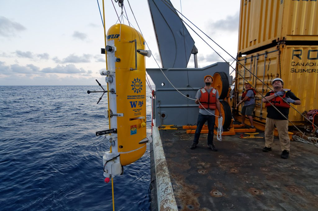 A modifed McLane profiler is clamped to the Deep Profiler Vertical Mooring, installed during the VISIONS'14 expedtition. Photo Credit: Ed McNichol, © 2014 Mumbian Enterprises, Inc., University of Washington. V14.