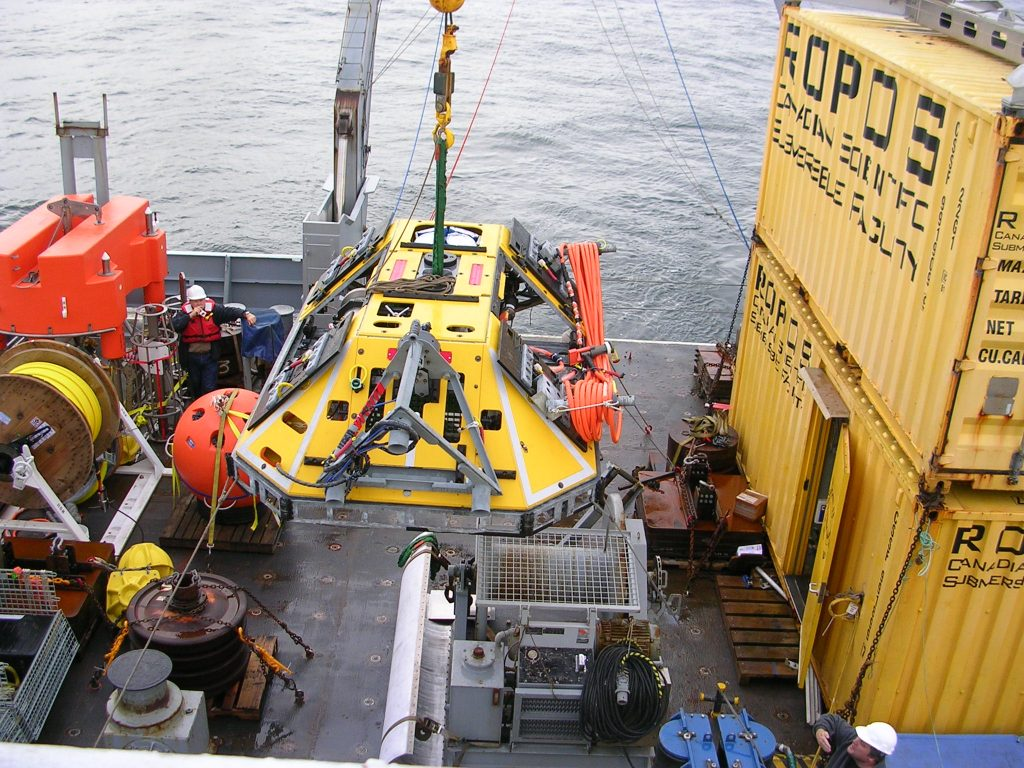 The Thompson crane moving the BEP from the aft deck to the ROPOS launch area, prior to deployment at Endurance Offshore (600 m depth).  Photo Credit: Rhea Sanders, Oregon State University