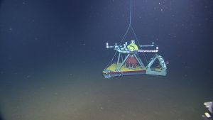 The HPIES (Horizontal Electrometer Pressure Inverted Echosounder) instrument on the seafloor at Axial Base site (2600m depth).  	Photo Credit: NSF-OOI/UW/CSSF, Dive 1739, V14