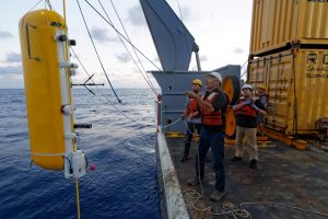 APL/RSN engineer Eric Boget gently lowers the deep profiler package into the water during the mooring deployment.  	Photo Credit: Ed McNichol, Mumbian Enterprises, Inc.